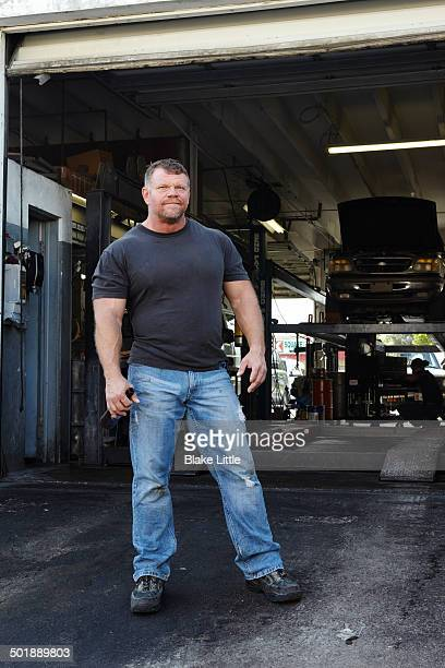 man at auto mechanics shop - handsome 50 year old men stock photos and pictures