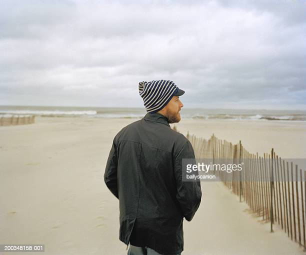 Man at beach, rear view