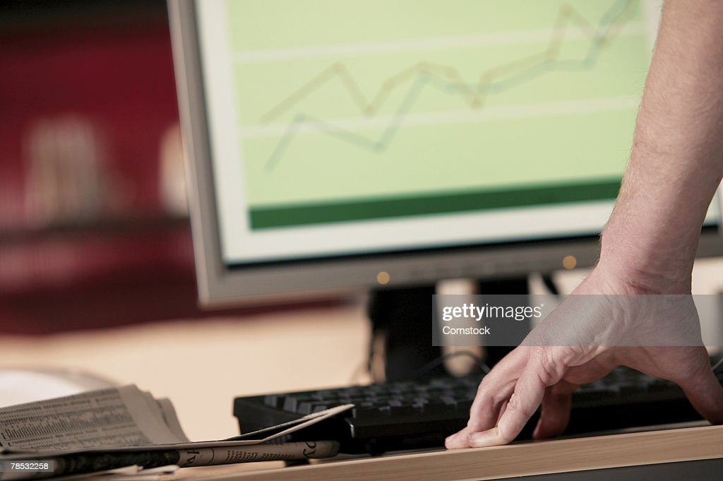 Man at computer : Stock Photo