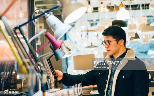 man at department store shopping electrical appliances - electrical equipment stock pictures, royalty-free photos & images