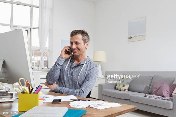 Man at desk on the phone
