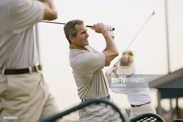 man at driving range - driving range stock pictures, royalty-free photos & images