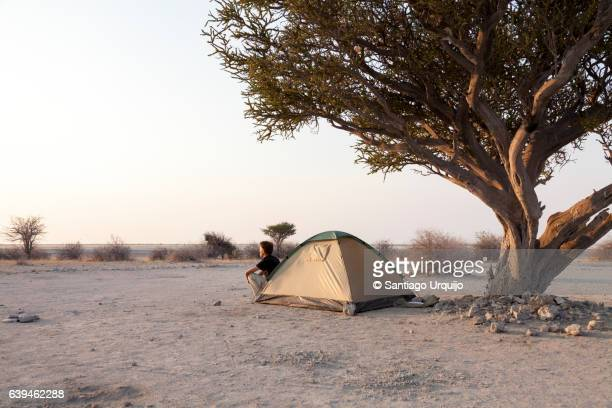 Man at entrance of his tent in Kubu Island