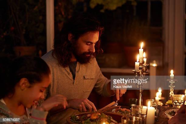 Man at family dinner i garden house