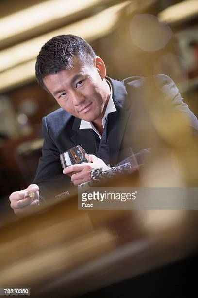 man at gambling table - gambling table stock pictures, royalty-free photos & images