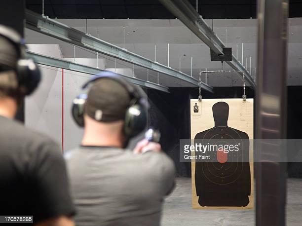 Man at gun shooting range.