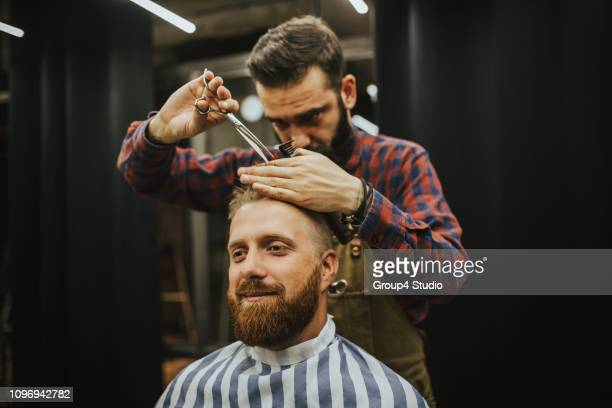 man at hair salon - hairstyle stock pictures, royalty-free photos & images