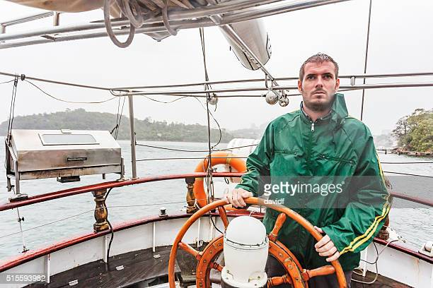 Man At Helm of Yacht During a Sydney Storm