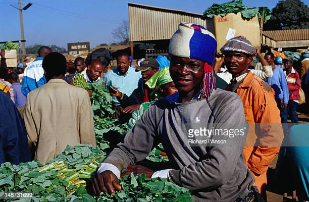 A man at his vegetable stall at the Mbare Market