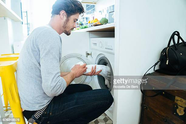 Man At Home Doing Laundry