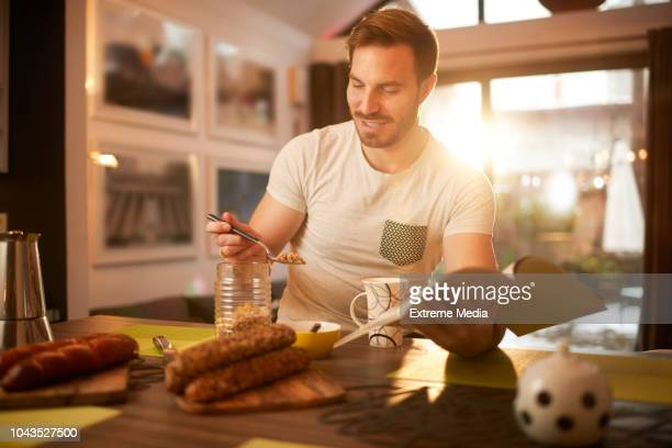 man at home having coffee and breakfast - sugar coffee stock photos and pictures