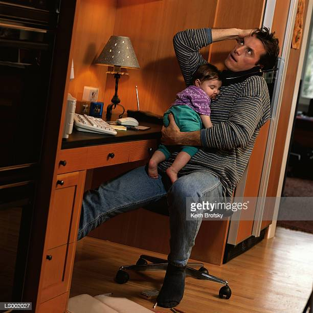 Man at Home Office with Baby