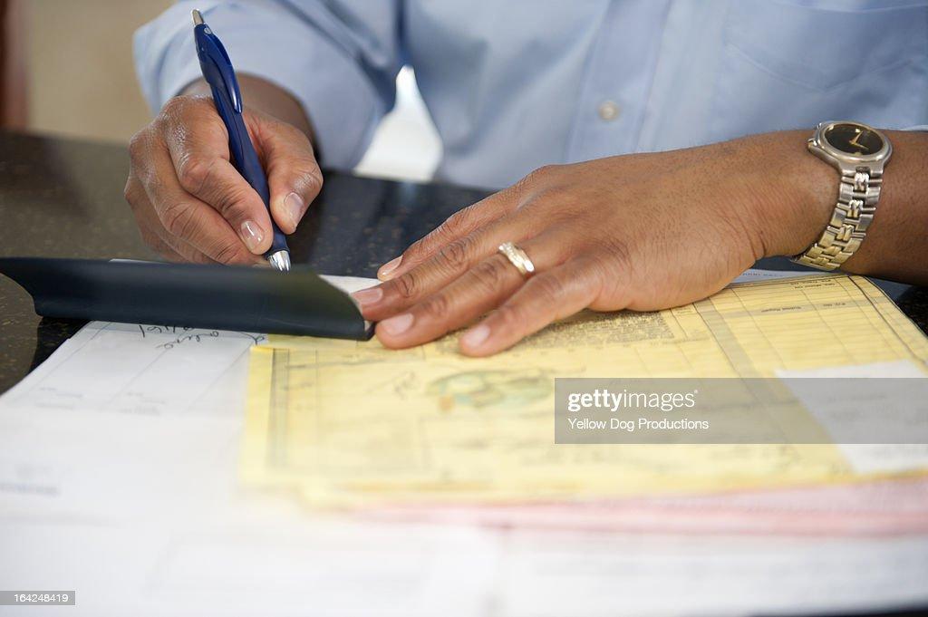 Man at home paying bills : Stock Photo