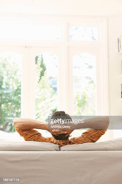 man at home relaxing - hands behind head stock pictures, royalty-free photos & images