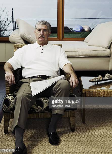 man at home with a newspaper - reclining chair stock photos and pictures