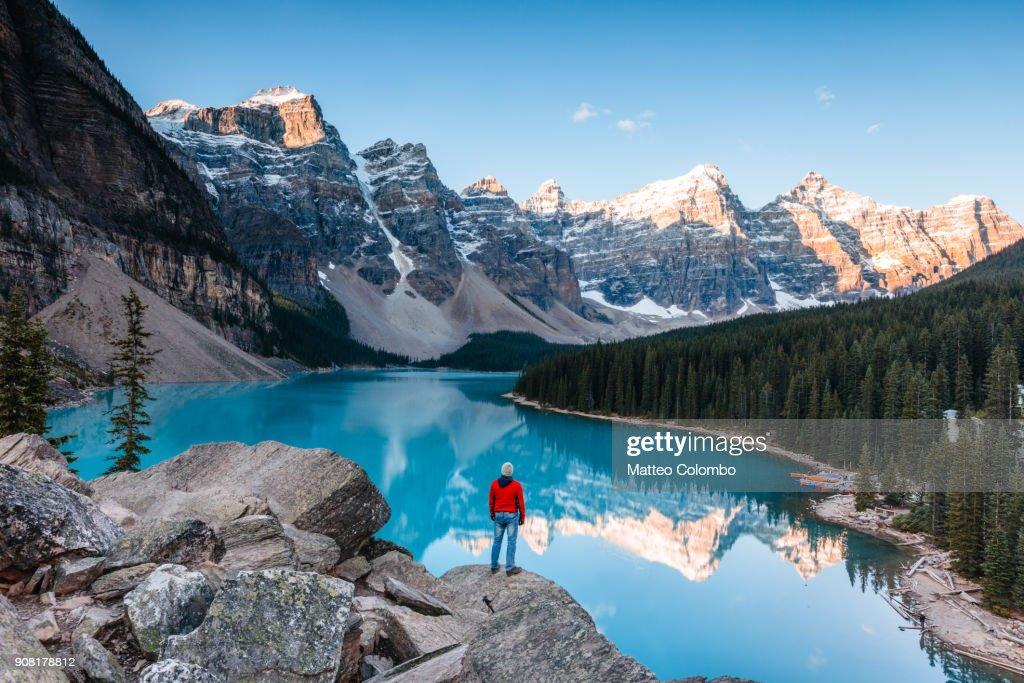Man at Moraine lake at sunrise, Banff, Canada : Stock Photo