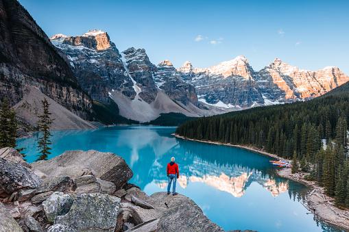 Man at Moraine lake at sunrise, Banff, Canada - gettyimageskorea