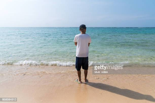 man at okinawa beach - tdub_video stock pictures, royalty-free photos & images