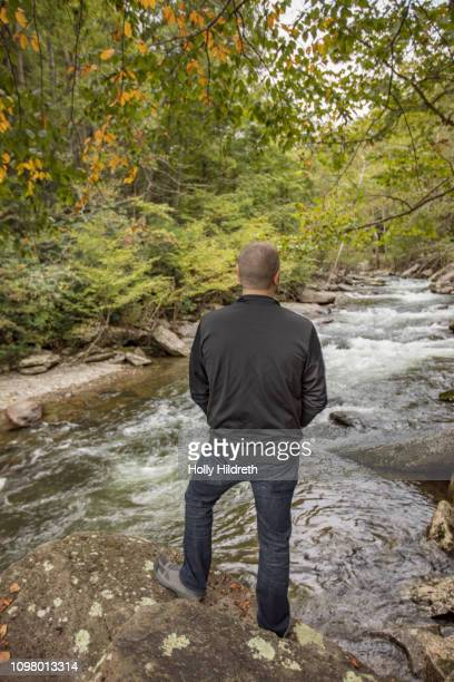 man at overlook on hike, enjoying nature - cades cove stock pictures, royalty-free photos & images
