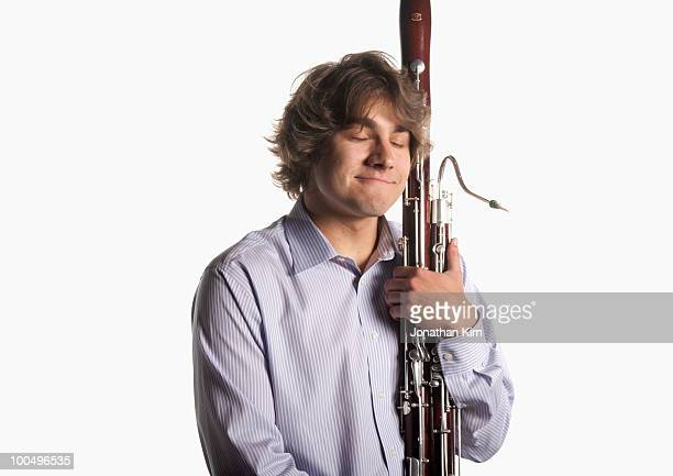 man at rest with his bassoon.   - bassoon stock pictures, royalty-free photos & images