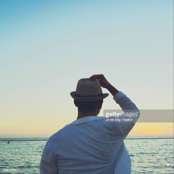 Man At Sea Against Clear Sky