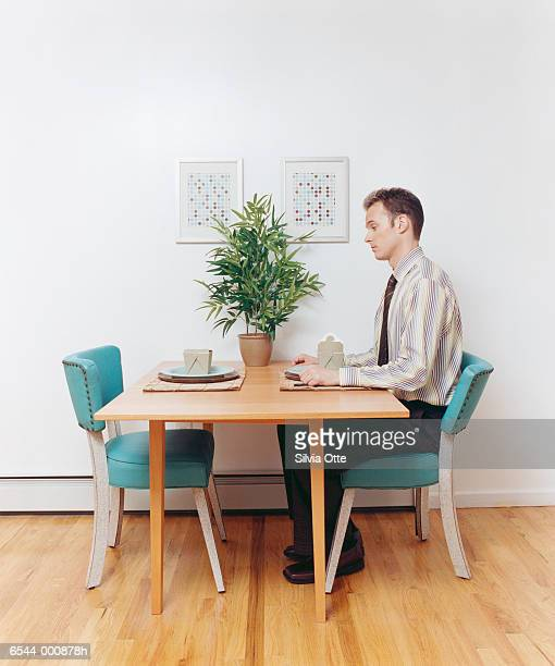 man at table with take-out - one young man only stock pictures, royalty-free photos & images