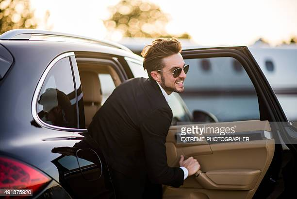 Man at the airport exiting from the car