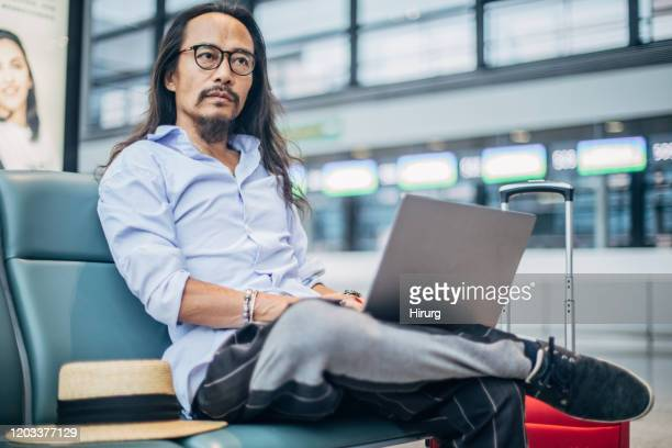 24 374 Asian Men Long Hair Photos And Premium High Res Pictures Getty Images