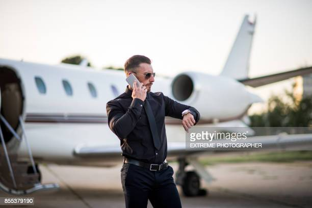 man at the airport - black shirt stock pictures, royalty-free photos & images
