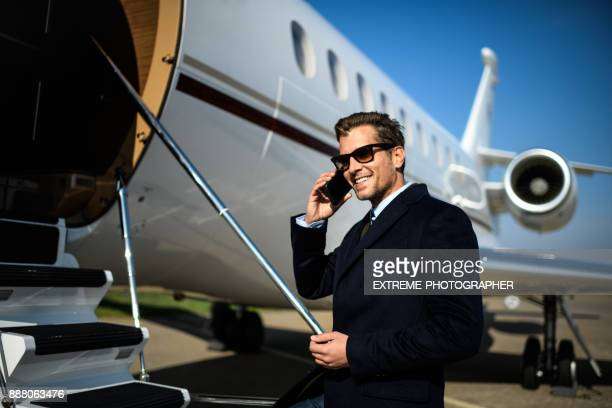 man at the airport - first class stock photos and pictures
