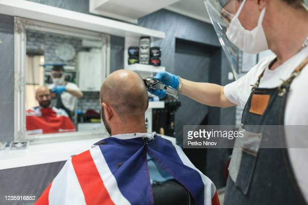 man at the barbershop after lifting coronavirus quarantine - hairdresser stock pictures, royalty-free photos & images
