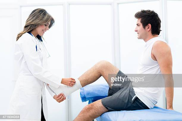 man at the doctor - sprain stock pictures, royalty-free photos & images