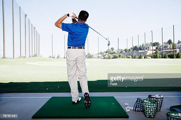 man at the driving range - driving range stock photos and pictures