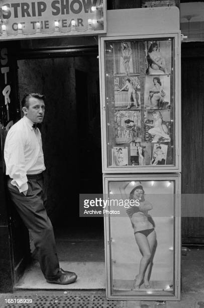 A man at the entrance to a strip club in Soho London April 1961