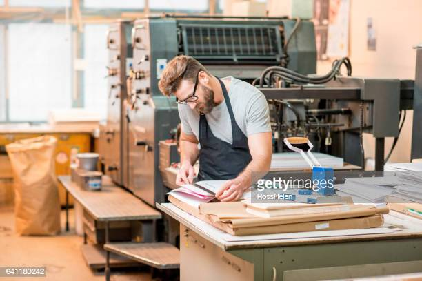 man at the old printing plant - lithograph stock pictures, royalty-free photos & images