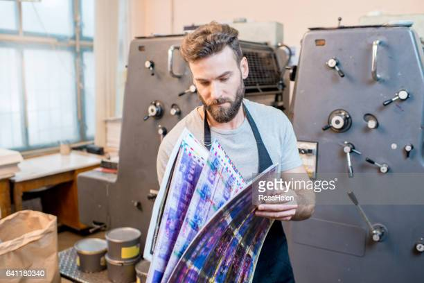 man at the old printing plant - printout stock pictures, royalty-free photos & images