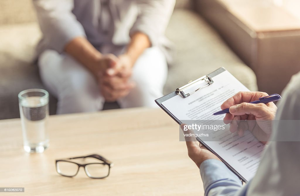 Man at the psychotherapist : Stock Photo