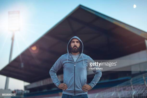 man at the stadium - football player stock pictures, royalty-free photos & images