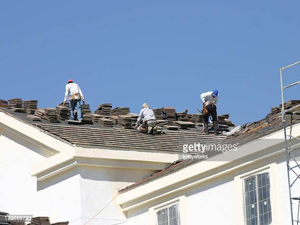 man at work 1 series - rooftop stock pictures, royalty-free photos & images