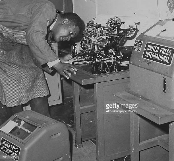 A man at work in the office of the Afro American newspaper Baltimore Maryland 1945