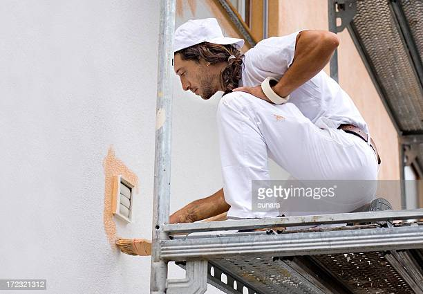 man at work - facade stock pictures, royalty-free photos & images
