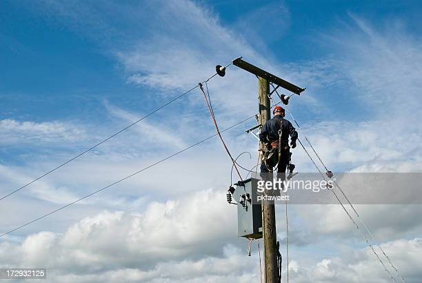 man at work - power line stock pictures, royalty-free photos & images