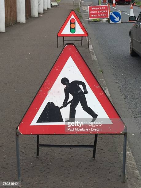 man at work sign on road - roadworks stock pictures, royalty-free photos & images
