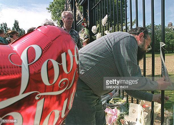 A man attaches a message to the gates of Kensington Palace with a balloon which reads I love you as people pay their respects 29 August two days...