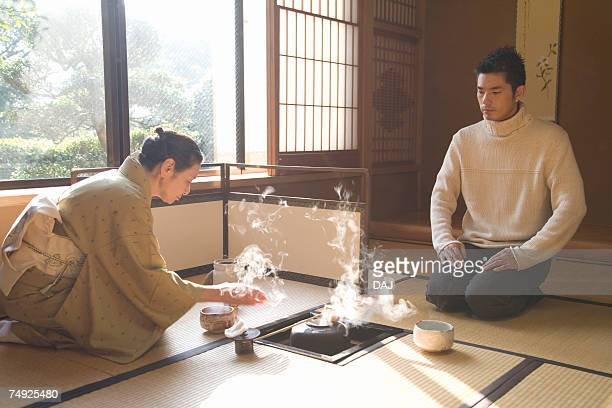 Man attending Japanese tea ceremony, front view, side view, Japan