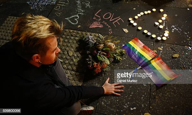 A man attends a candlelight vigil for the victims of the Pulse Nightclub shooting in Orlando Florida at Newtown Neighbourhood Centre on June 13 2016...