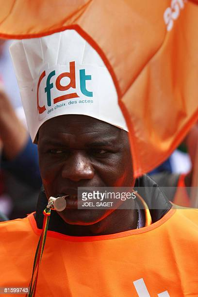 A man attends a demonstration of thousands of people as part of a nationwide strike called by the two biggest unions CGT and CFDT on June 17 2008 in...