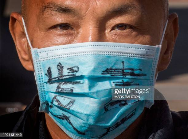 A man attends a memorial for Dr Li Wenliang who was the whistleblower of the Coronavirus Covid19 that originated in Wuhan China and caused the...
