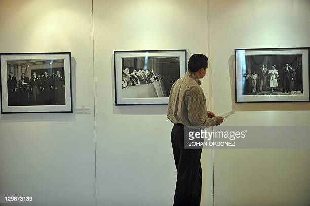 A man attends a photography exhibition dedicated to former Guatemalan President Jacobo Arbenz on October 19 at the Culture Palace in Guatemala City...