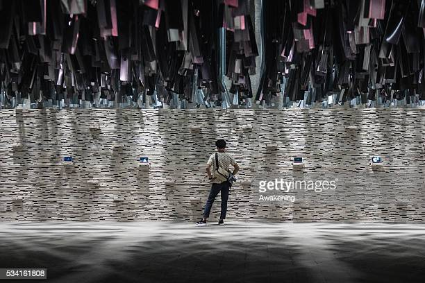 A man attends at the Reporting from the Front pavillon of the 15th Architecture Venice Biennale on May 25 2016 in Venice Italy The 15th International...